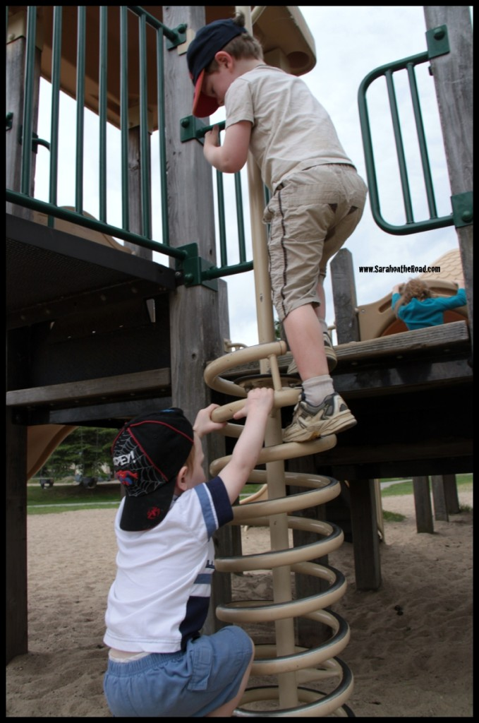Boys climbing on play structure