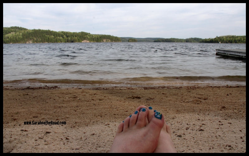 Feet on beach at Haliburton Lake