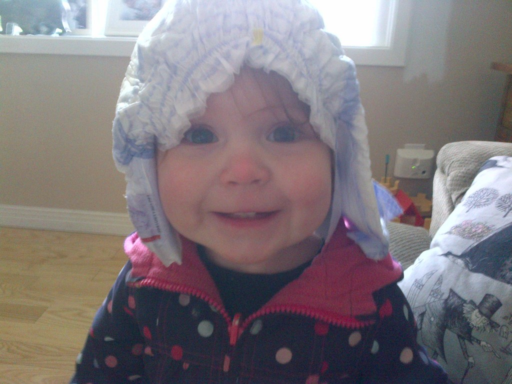 Toddler with diaper on head
