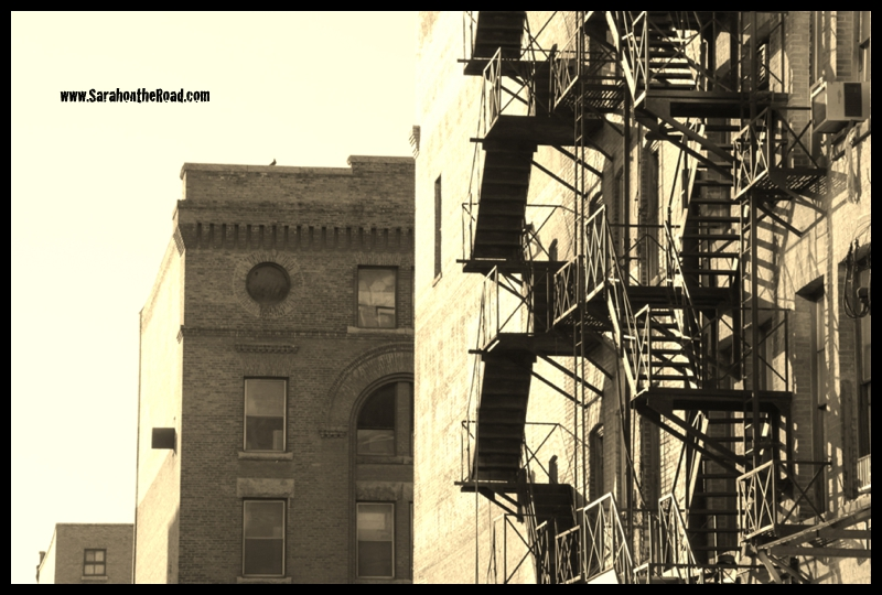 sepia shot of alley/street with fire escapes!