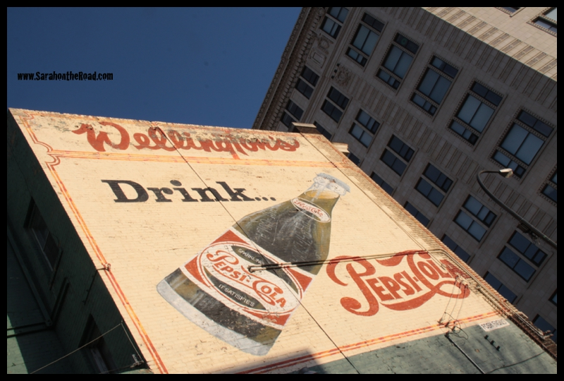 old coke ad on side of brick building