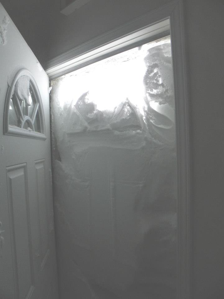 5plex door- filled with snow